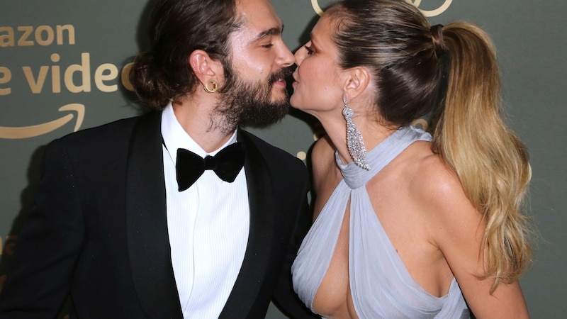 Heidi Klum küsst Ehemann Nummer 3, den 17 Jahre jüngeren Sänger Tom Kaulitz.