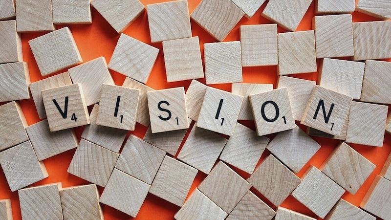 Die Vision eines Unternehmens beschreibt eine zukünftige Wirklichkeit, die auf Basis der Mission angestrebt werden soll.