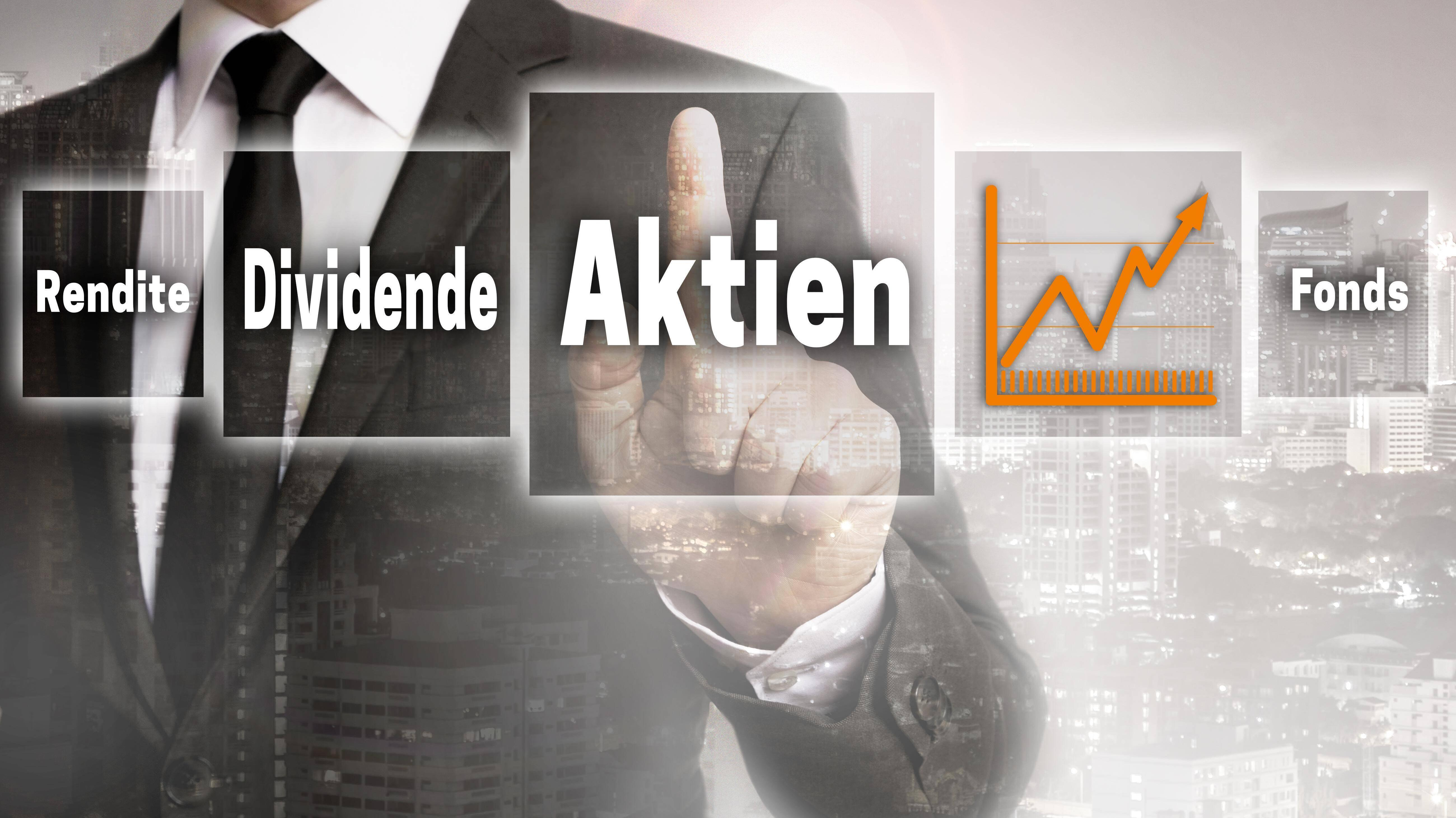Aktien (in german shares, dividend, fund, yield) Businessman with city background concept Copyright: x8vfanPx Panthermedia28257187