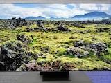 Der 65-Zoll-Fernseher sorgt mit Riesen-Bild für Heimkino-Genuss.