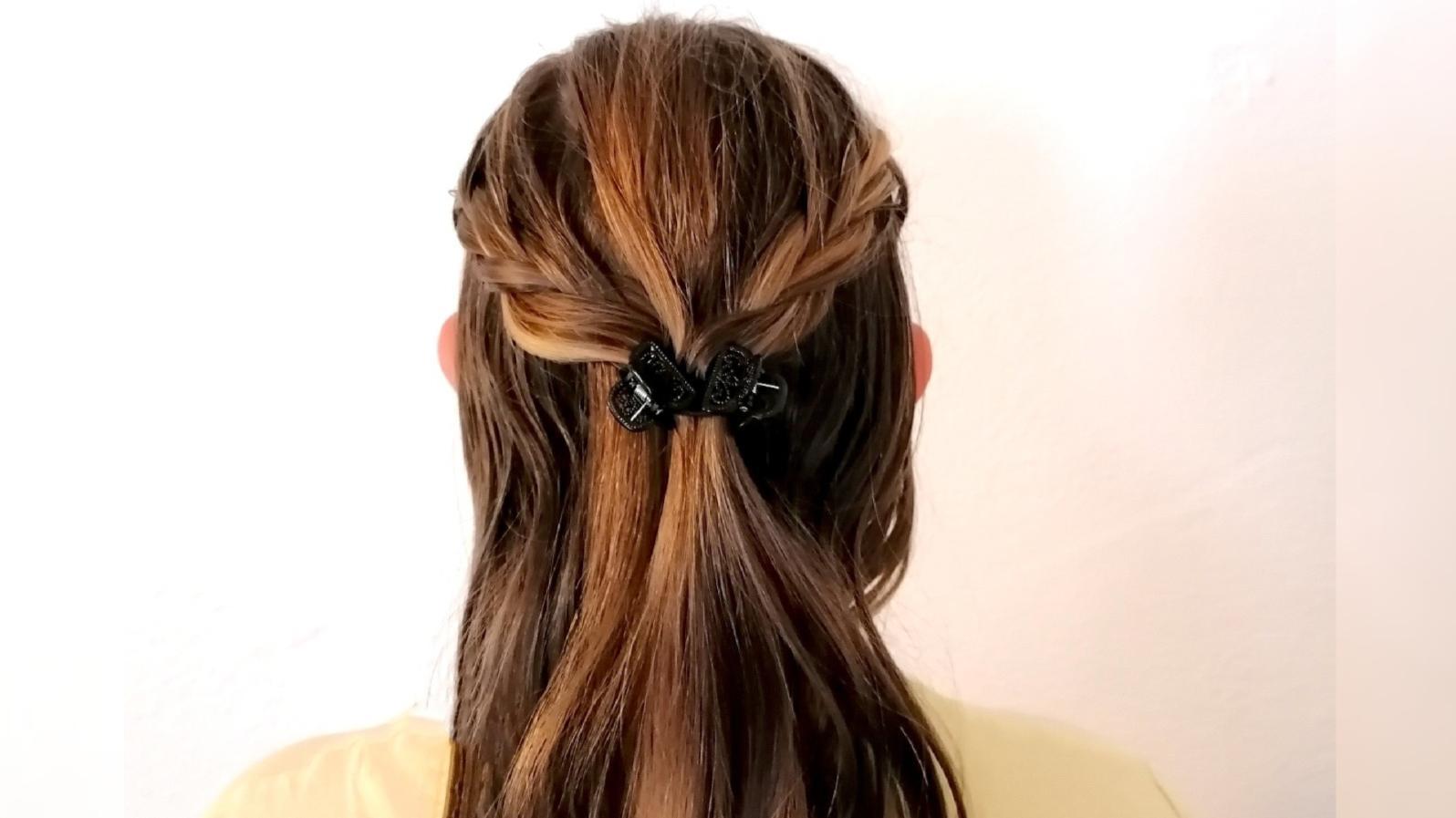 Eine schöne klassische Frisur können Sie auch mit Haarklammern gestalten.
