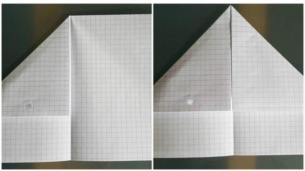 Um diesen Schritt einfacher zu machen, knicken Sie das Blatt noch einmal und legen Sie dann beide oberen Ecken an die Mittellinie.